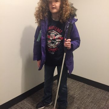 Madilyn with her white cane