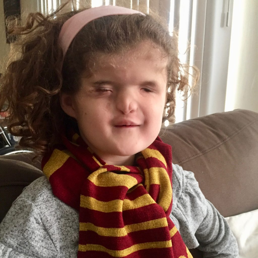 Madilyn wearing her Gryffindor Scarf