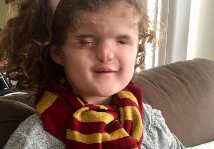 Madilyn wearing her Gryffindor Scarf